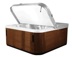 Hot tub with Teak cabinet color, with cover lifted.