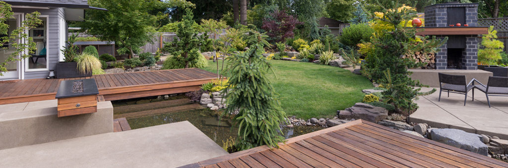 A beautiful backyard with an open spot on the deck awaiting a Marquis hot tub.
